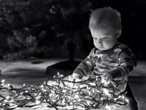 Baby boy with Christmas lights Stock Photo