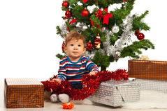 Baby boy with Christmas presents Stock Photo