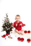 Baby boy with christmas tree Stock Photos