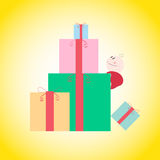 Baby boy climbs the gift pile Royalty Free Stock Photos