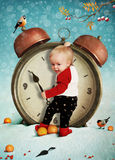Baby boy and clock. Royalty Free Stock Photography