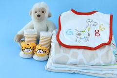 Baby boy clothes. Stack of boy clothing for baby  on blue background Stock Image