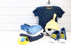 Baby boy clothing set blue t-shirt with white stars, jeans shir Stock Images
