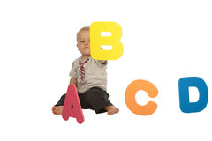Baby Boy with Colorful Alphabet. Little Baby Boy Sitting in Front of Colourful Letters Stock Photography