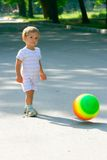 Baby boy with colorful ball. Walking in park Royalty Free Stock Photos
