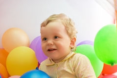 Baby boy with colorful balloons Royalty Free Stock Images