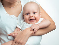 Baby boy in the comfort of moms arms Stock Photo