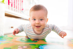 Baby boy crawl on the floor Stock Photos