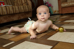 Baby boy crawling on the floor Stock Images