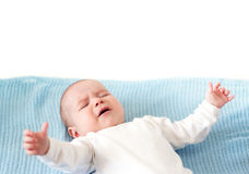 Baby boy crying. On blue blanket on white background Royalty Free Stock Images