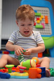 A baby boy crying in children room Royalty Free Stock Image