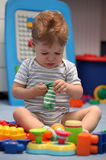 A baby boy crying in children room Royalty Free Stock Images