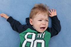 A baby boy crying. On a floor Stock Photography