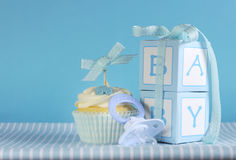 Baby boy cupcake with dummy and gift boxes. Blue theme baby boy cupcake with dummy pacifier and gift boxes for baby shower or new born nursery greeting card Stock Photography
