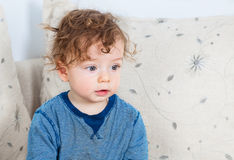 Baby boy with curly hair Stock Photos