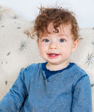 Baby boy with curly hair Stock Photography