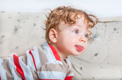 Baby boy with curly hair Royalty Free Stock Images