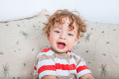 Baby boy with curly hair Royalty Free Stock Photography