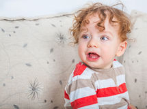 Baby boy with curly hair Royalty Free Stock Photo