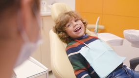 Cute baby in a striped sweater on reception at the dentist