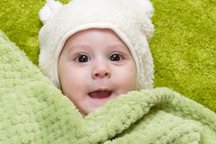 Baby boy under the green towel Royalty Free Stock Image