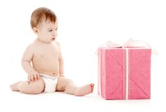 Baby boy in diaper with big gift box Royalty Free Stock Photos