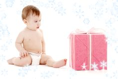 Baby boy in diaper with big gift box and Stock Photography