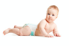 Baby boy in diaper lying isolated Stock Photos