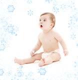 Baby boy in diaper with toothbrush Royalty Free Stock Photos