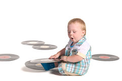 Baby boy DJ playing with vynil disks Royalty Free Stock Image