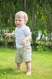 Baby boy doing first steps Stock Photography