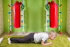 Baby boy doing strength exercise perfect plank .Physical education,fitness,sports.concept of a healthy lifestyle. Physical education,fitness,sports.concept of a royalty free stock images