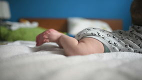 Baby boy doing tummy time stock video footage