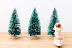 Baby boy doll and motorbike with chrismas trees background Stock Image