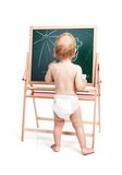 Baby boy drawing on chalkboard over white Stock Images
