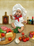 Baby boy dressed as a cook Royalty Free Stock Photography