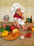 Baby boy dressed as a cook Stock Photography
