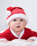 Baby boy dressed as santa claus Stock Images