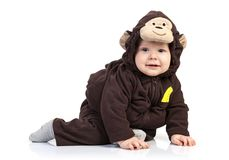 Baby boy dressed in monkey costume over white Stock Image