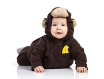 Baby boy dressed in monkey costume on white. Baby boy dressed in monkey costume over white background Royalty Free Stock Images