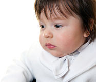 Baby boy dressed in white Stock Images