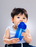 Baby boy drink water. With gray background Royalty Free Stock Photos