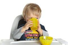 Baby boy drinking Stock Photo