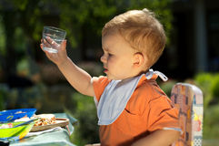 Baby boy drinking Royalty Free Stock Image