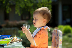 Baby boy drinking royalty free stock photos