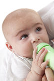 Baby boy drinking from a baby bottle Royalty Free Stock Photos
