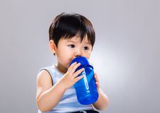 Baby boy drinking from bottle Stock Image