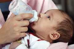 Baby boy drinking milk bottle Royalty Free Stock Photos
