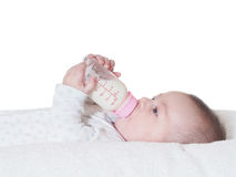 Baby boy  drinking milk from the bottle isolated Stock Photos