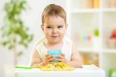 Baby boy drinking milk indoors Stock Photo